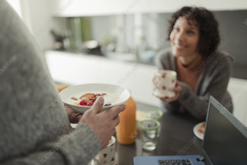 Couple eating breakfast and talking