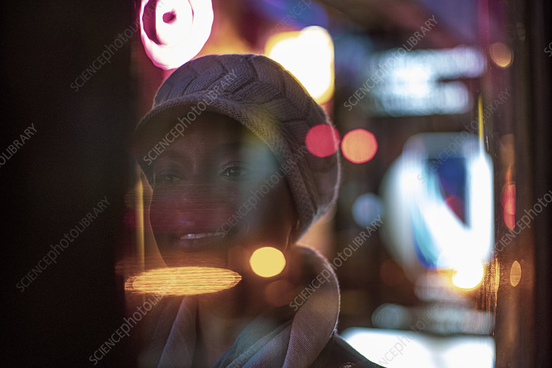 Lights around young woman in hat