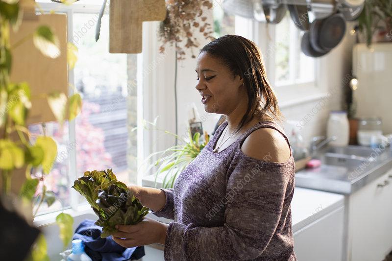Woman holding fresh lettuce