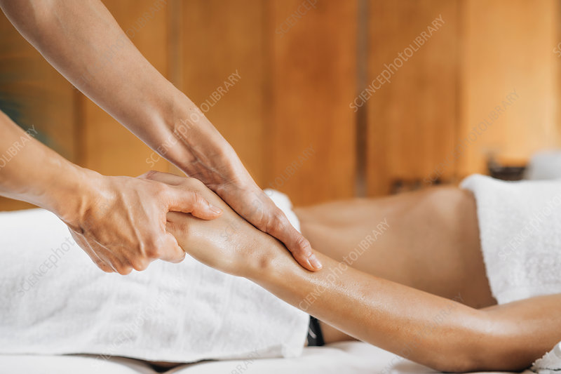 Ayurveda therapeutic arm massage with ethereal oil