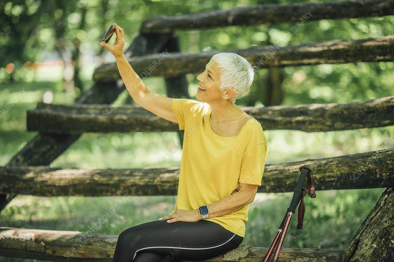Senior woman taking a break after a workout