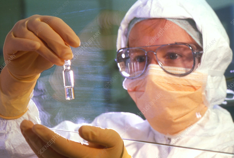 Researcher with a vial containing a virus