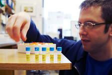 Researcher with vials of DNA BioBricks