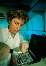 Researcher loads PCR equipment to clone foetal DNA