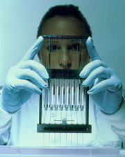 Technician preparing samples for DNA sequencing