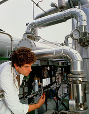 Technician working at a sugar concentration plant