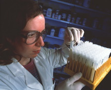 Researcher with milk samples