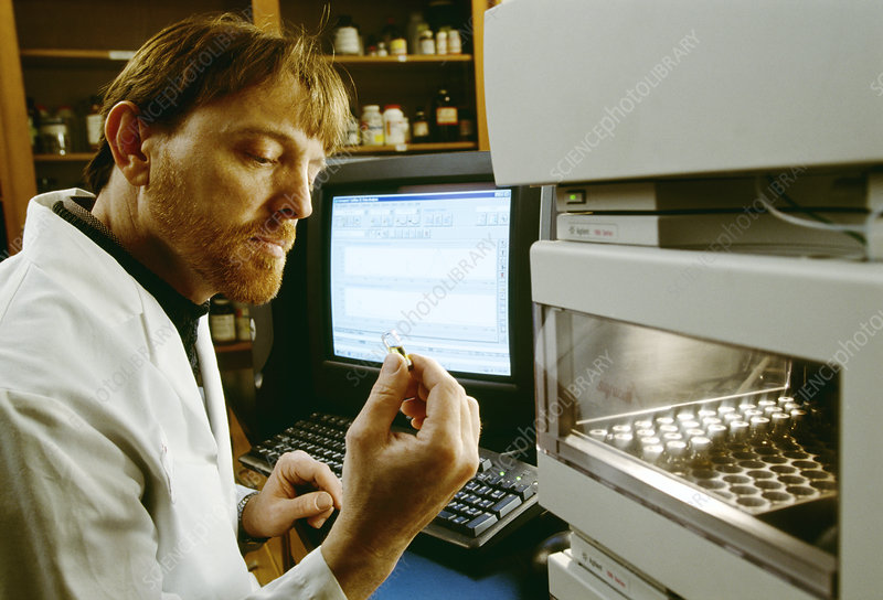 Technician using a spectrophotometer