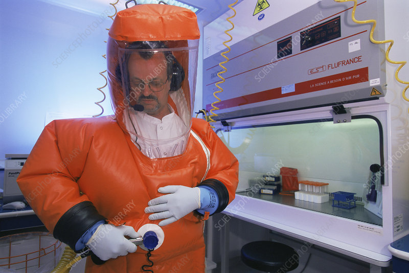 Virologist using a protective suit