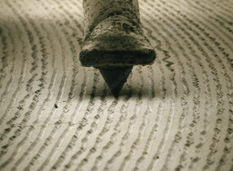 SEM of diamond stylus in groove of LP record