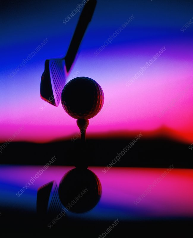 Close-up of golf club & ball