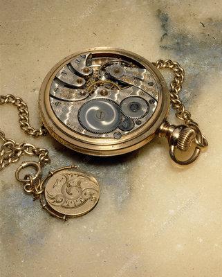 The internal mechanism of a pocket watch