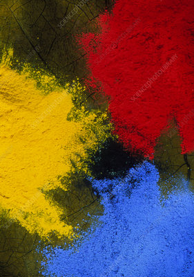 Three piles of powder paint in primary colours