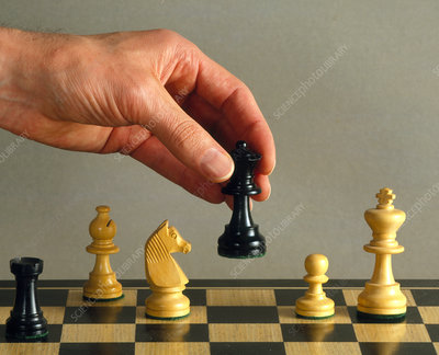 Hand moving a piece during a game of chess