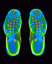Coloured X-ray of the soles of two trainer shoes