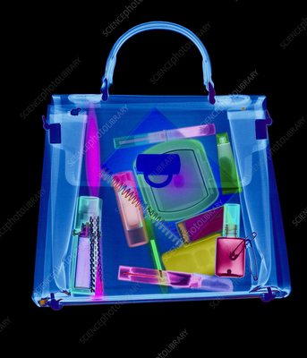 Coloured X-ray of woman's handbag showing