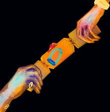 Coloured X-ray of hands pulling a party cracker