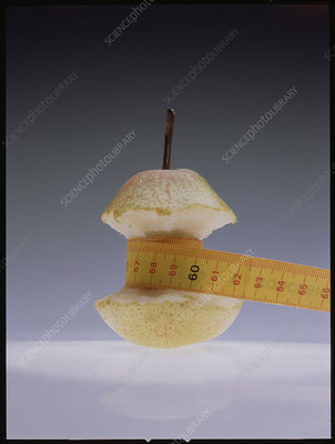 Tape measuring half-eaten pear