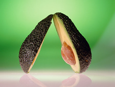 Avocado pear, cut in half to reveal stone