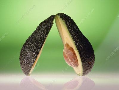 Avocado pear, cut in half to reveal stone