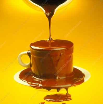 Molten chocolate being poured into a cup