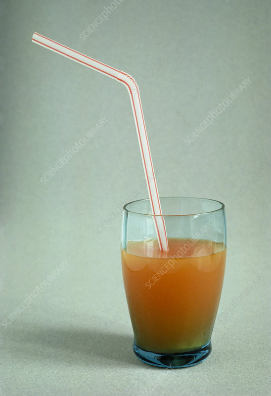 A bent straw in a glass with a soft drink