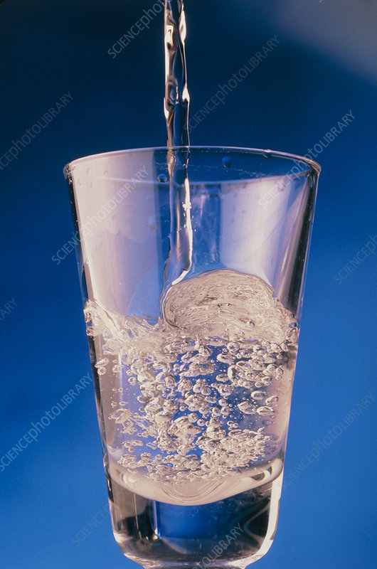 Close-up of water being poured into a glass