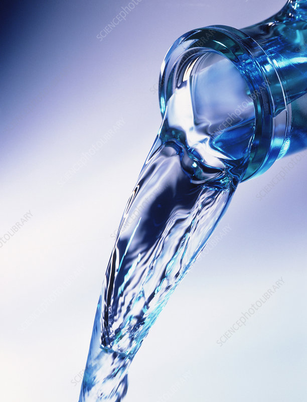 Water pouring from a bottle