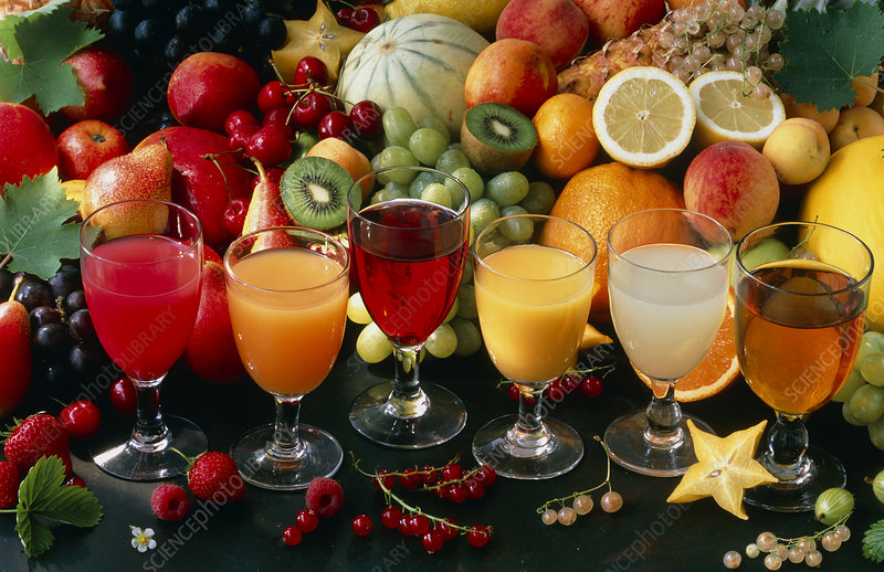 View of an assortment of fruits and their juices