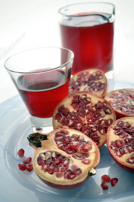Pomegranate fruits and juice