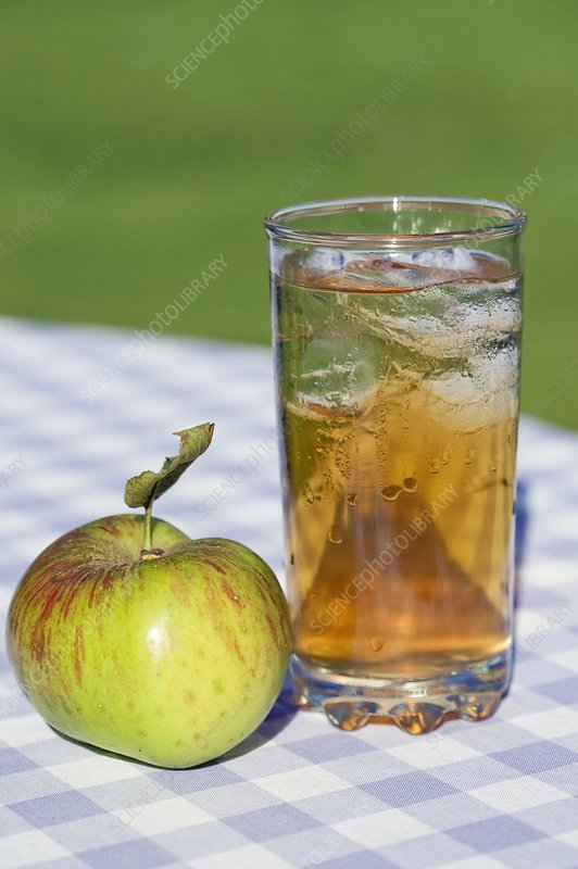 Apple and glass of apple juice