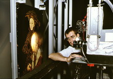 Technician uses infra-red scanner on forged art