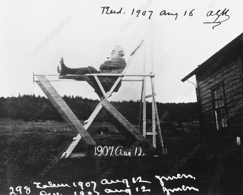 Alexander Graham Bell sitting in tetrahedral chair
