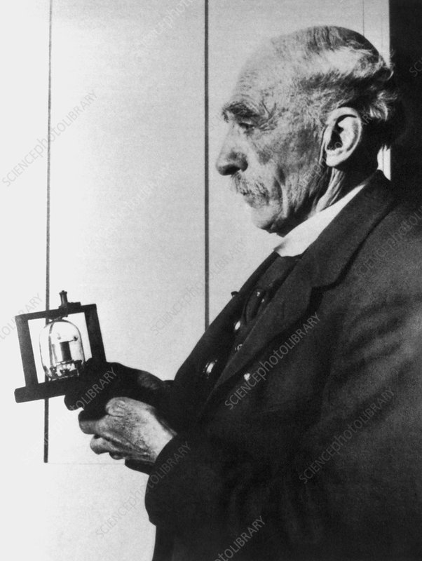 Photo of Sir John Fleming with a thermionic valve