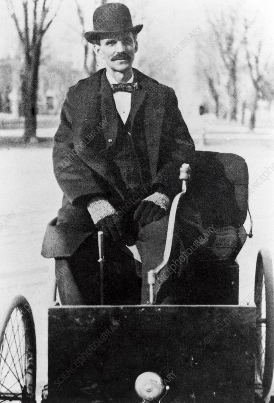 Henry Ford riding on his 1896 motor quadricycle
