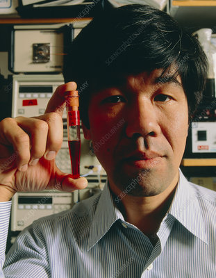 Dr K.Nagai with tube of haemoglobin blood sub'ute