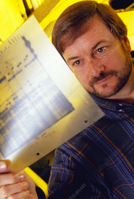 Geneticist, Oliver A. Ryder, with condor DNA map