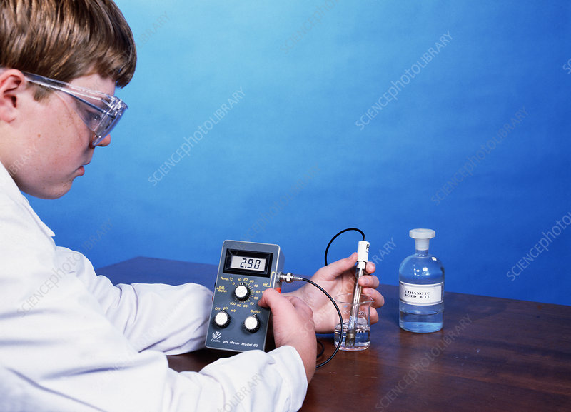 Chemistry student measuring pH