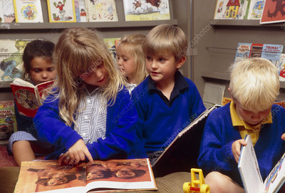 Young schoolchildren reading books