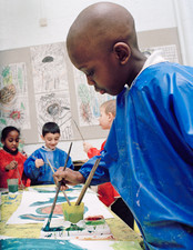 Boy painting at school