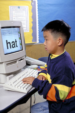 First grade student working on a computer