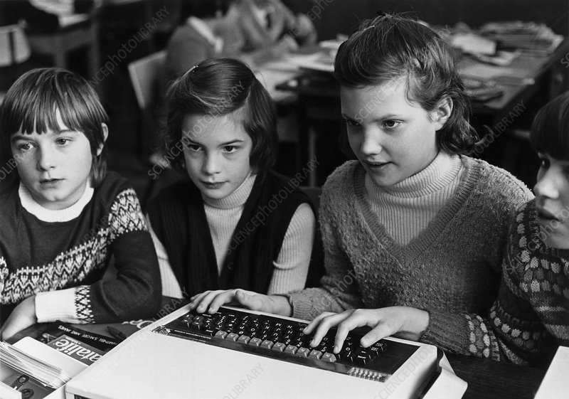 Schoolgirls use a computer