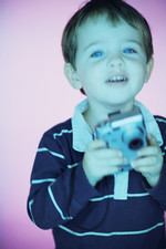Boy with digital camera