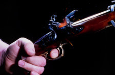 A flintlock pistol being fired
