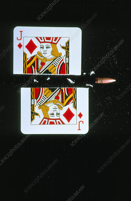 High-speed photo of bullet cutting a playing card