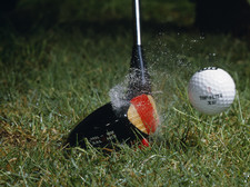 High speed photograph of a golf ball strike