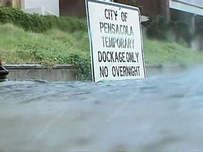 Street under water, CU on sign