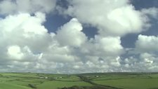 Cumulus clouds over fields