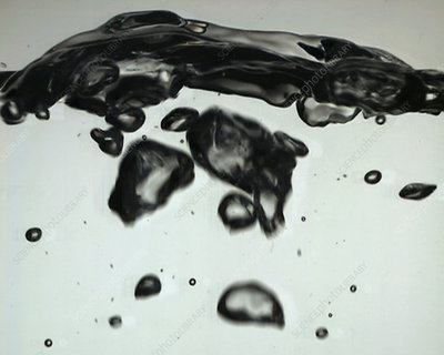 Water surface broken by rising bubbles