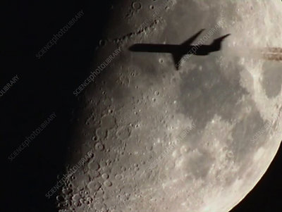Aeroplane passing in front of the Moon